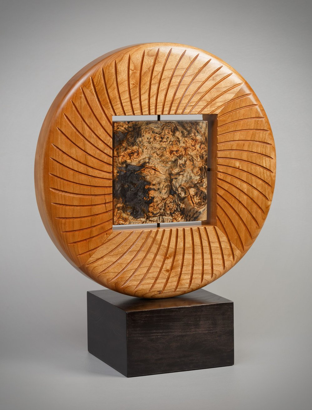 """Burl Sun Disc - 16"""" diameter x 2"""" deep.  Cherry and toasted maple burl, finished in tung oil."""