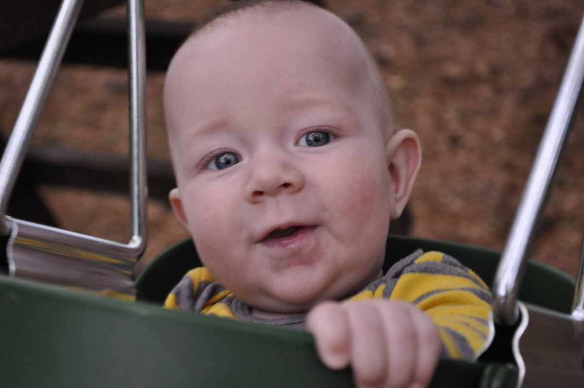 Ezra swinging at Grandpa Jim's