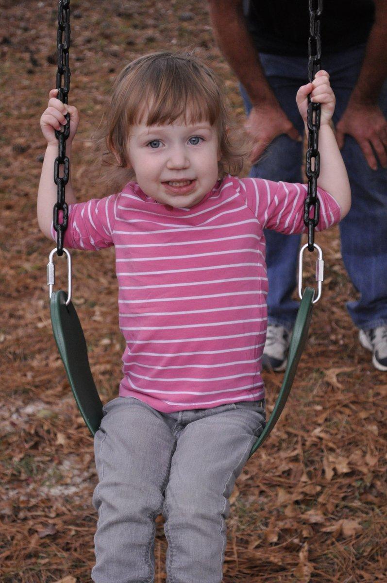 Harper swinging at Grandpa Jim's