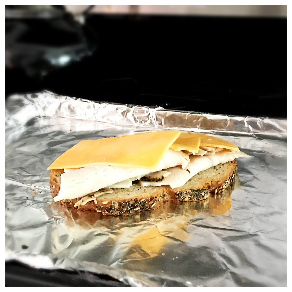 4.  Place the slice of toasted bread with turkey onto a baking sheet.    5.  Top turkey with the cheese slices, making sure to cover the   turkey with the cheese in an even layer.          (I lined the baking sheet with foil for easier clean-up)