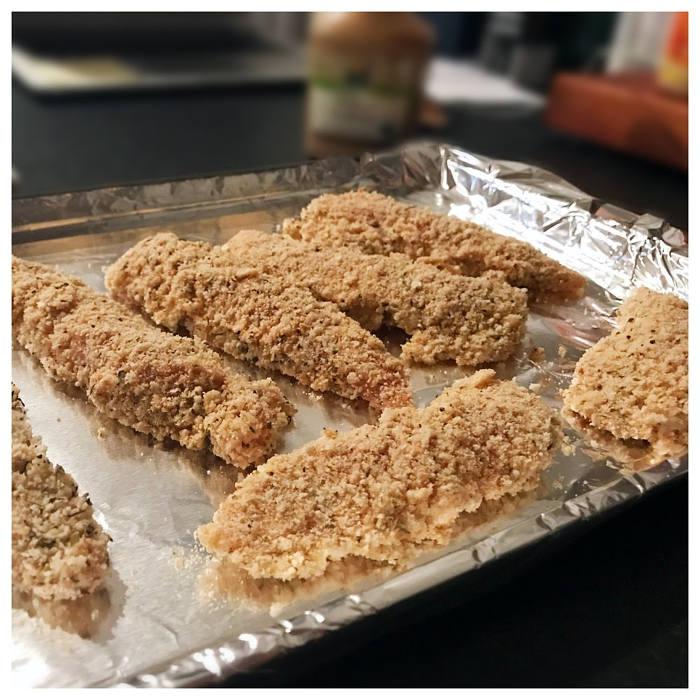 5.  Place each coated chicken tender on the lined baking sheet. 6.  Bake tenders in preheated oven for about 15 - 20 minutes (depending on size & thickness of your chicken tenders).