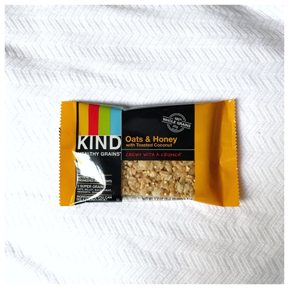 KIND Healthy Grain Bars  - Honey Toasted Coconut bar   Nutrition Info   This is currently one of my favorite snack bars. It's the perfect size to keep hunger off until lunch or dinner time or it makes a great part of a breakfast or lunch. This bar contains  3 grams of protein ,  2 grams of fiber  and  6 grams of sugar .   Workout Fuel   While I would not eat this bar, the minute before I go out for a run or workout, it's minimal protein, fat (5 grams total), and fiber could still allow me to enjoy it about 30 to 45 minutes or so before a workout (this is my personal experience - every athlete and exerciser is different). I would definitely choose this bar over one of the nut-filled bars before my run or workout. Those other bars filled with nuts are also filled with fat and fiber and a little more protein,which, as I mentioned earlier, while fine on its own, may not be the best right before intense physical activity.   Food Allergy Friendly   Many KIND bars are filled with almonds, peanuts, pistachios and more, so I was excited to find this one with that did not contain any nuts or peanuts. Hurray! It is processed in a plant that processed peanuts and tree nuts, though, so be careful if this would affect you.