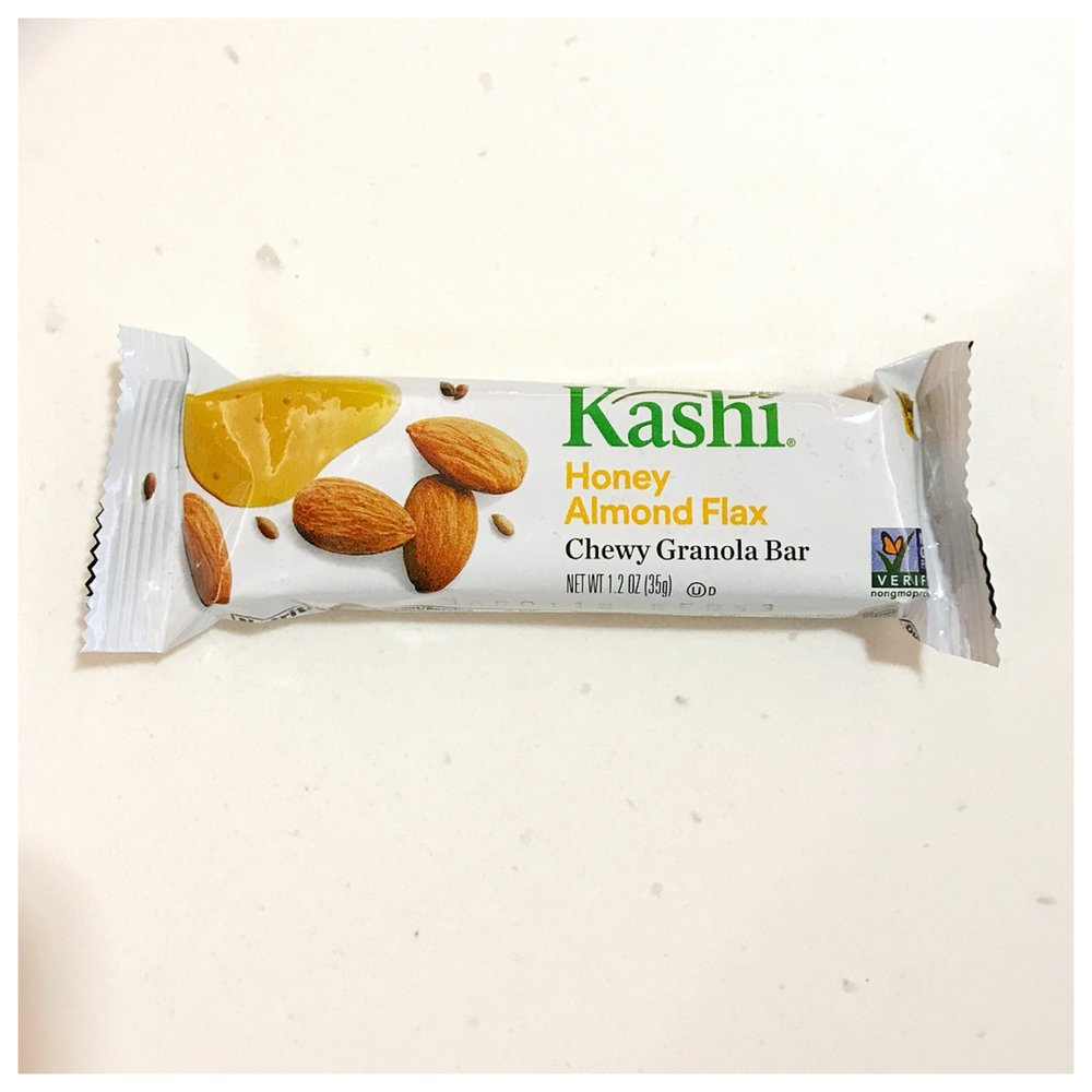 """KASHI TLC    Nutrition Info   I discovered these bars years ago because they were one of the bars consistently offered in our hospital cafeteria. I like these guys because they are a good """"snack portion"""" or a little something extra at a meal. They have around  6 grams of protein ,  6 grams of sugar,  and  3 grams of fiber  per bar. Due to the nuts, they also contain poly and monounsaturated fats.   Workout Fuel   Because these particular bars contain a good amount protein, fiber, and fat, for many they are best eaten further out from exercise. They could make a great mid-morning or mid-afternoon snack or part of a balanced breakfast or lunch.   Food Allergy Friendly   These bars may not be the right pick for friends with food allergies, but if you're food allergy free, they can be a good fueling snack to help get you through your day."""