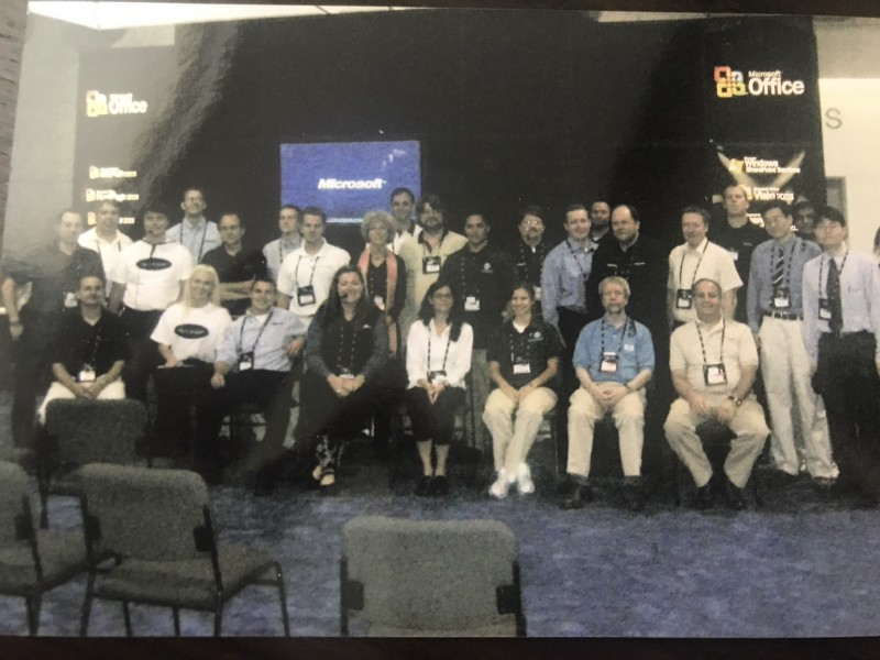 Our First Office System Demo Theatre in the Expo Hall, Circa 2003. Me, middle, headset.