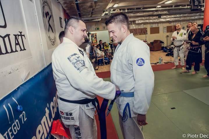 Receiving the Purple Belt from Professor Jaro Koch in Szczcecin, Poland