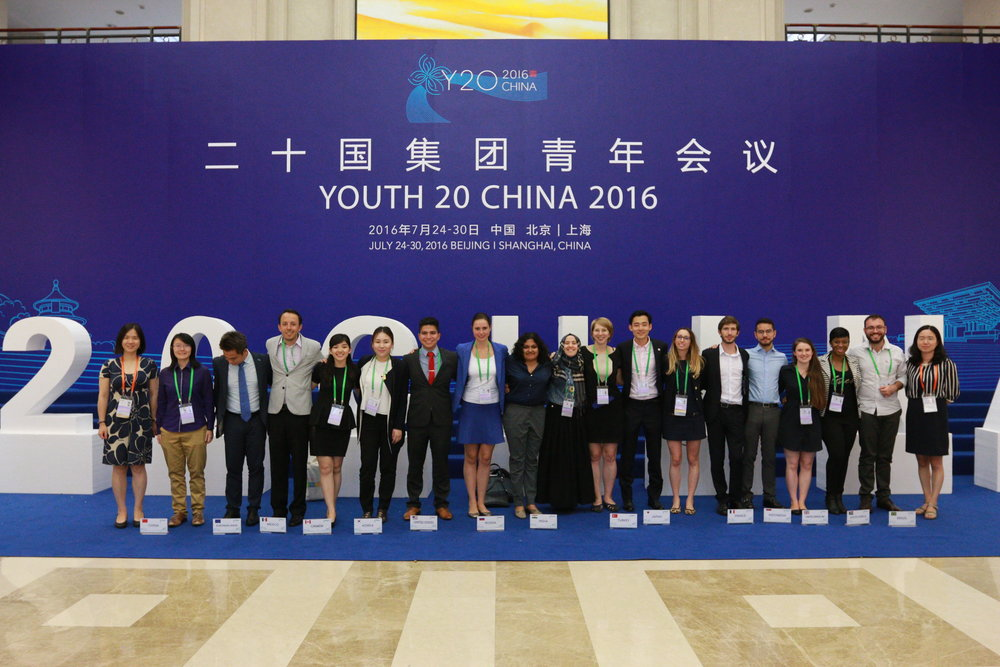 head delegates from the y20 china summit pose for a group photograph