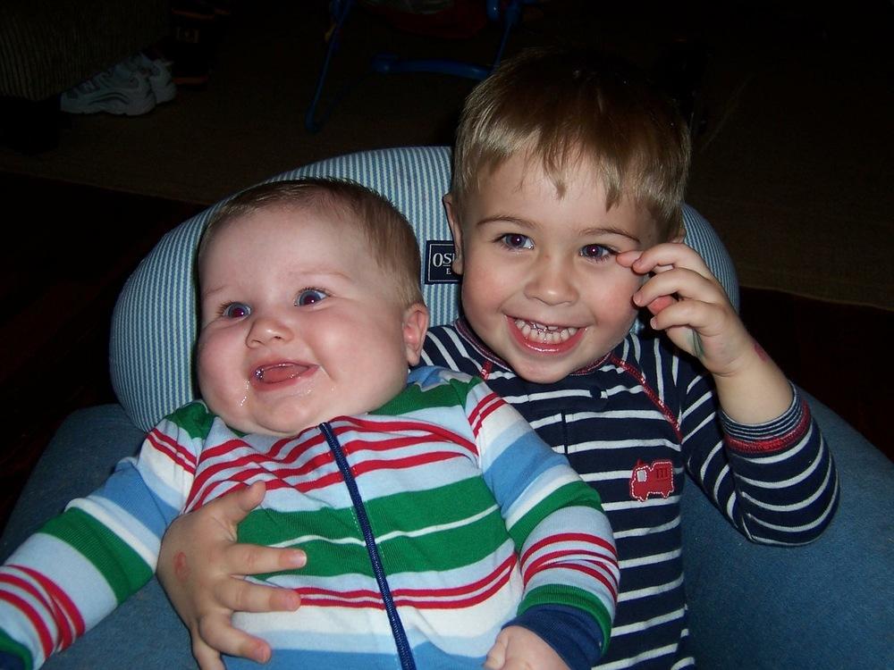 E hugging Sam in blue chair 2007.jpeg