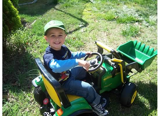 E sitting on little tractor 2007.jpeg