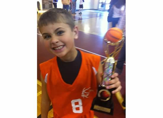 E holding basketball trophy.jpeg