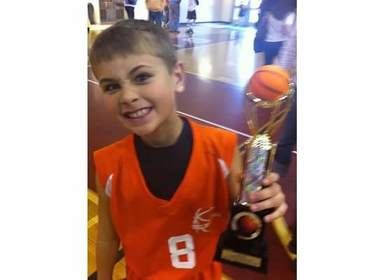 E holding basketball trophy.jpeg
