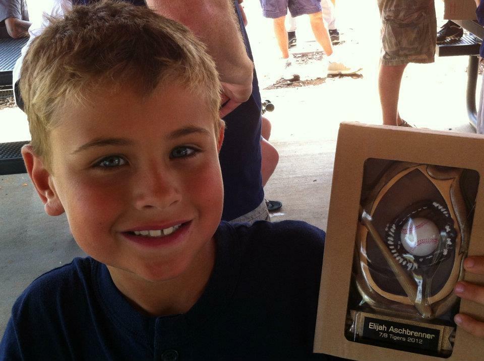 E with baseball trophy.jpeg