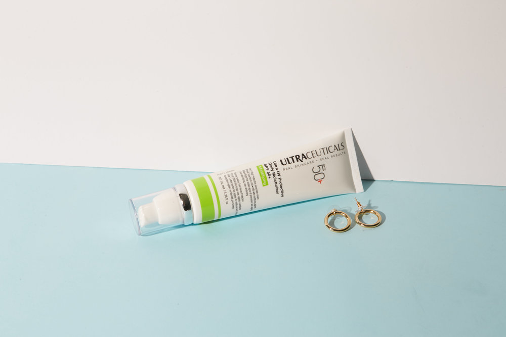 Ultraceuticals Daily Moisturiser SPF 50+ | Earrings by Meadowlark