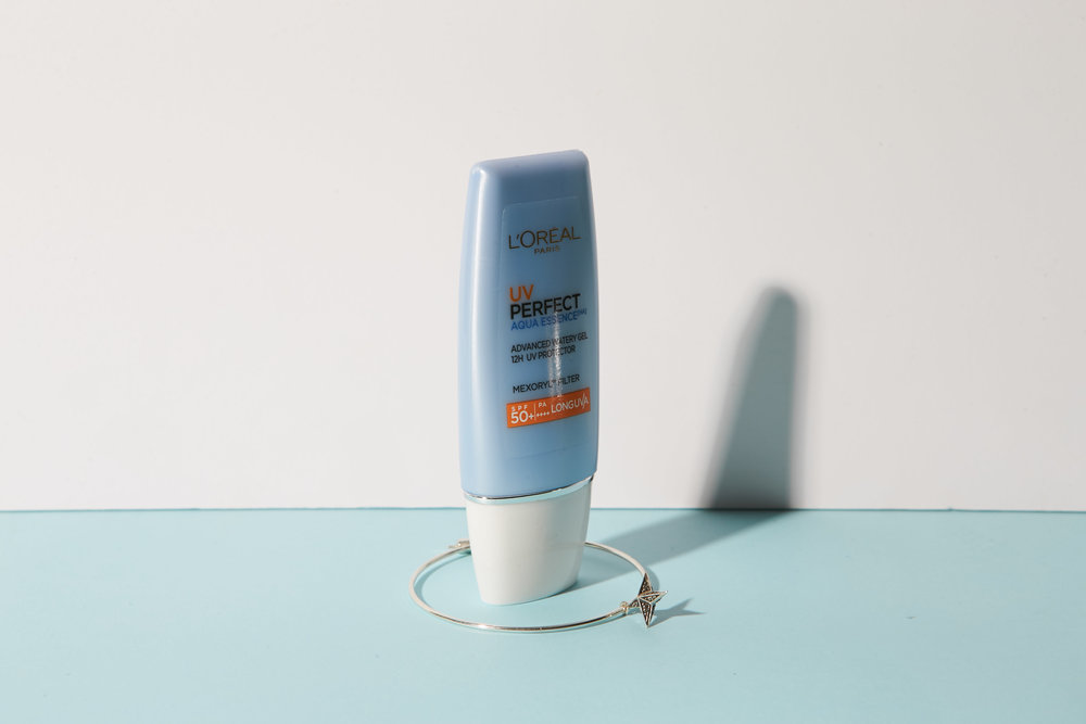 L'Oreal Paris Aqua Essence spf 50+ | Single hoop earring by Meadowlark