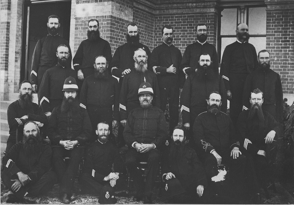 Sub-Inspectors, Senior Sergeants, Sergeants and Senior Constables stationed at Brisbane during 1888 outside Roma Street Barracks (PM064a).  Source: QP Museum