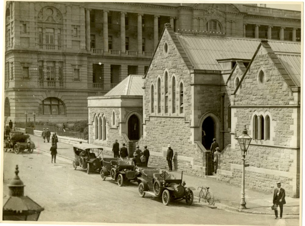 Old CIB building (church) corner Elizabeth and George Streets, Brisbane, where Queen Victoria park is now located. Lands Department Building is shown in rear of photograph. Image No. PM0204b courtesy of the Queensland Police Museum.