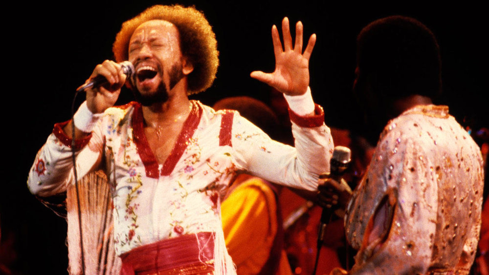 MAURICE WHITE (1941-2016) - The producer / songwriter / musician / front man / creator of   Earth, Wind & Fire  , the multi-award-winning band that became the voice of a generation in the 70s-80s, the sound of sophisticated jazz-fused funk and purveyors of an Afrofuturistic aesthetic that lit a flame that burns even brighter today, 30 years later.