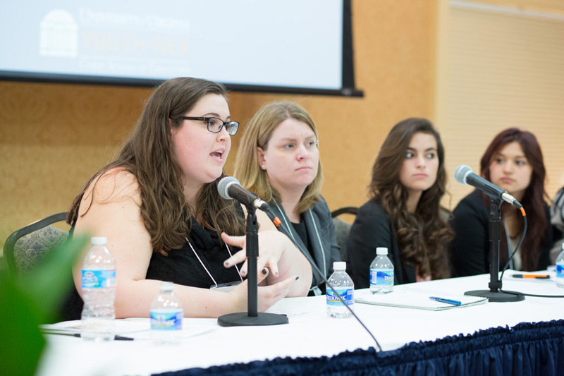 Jovanna Sanchez  (second from right) and  Daniela Montes  (right) speak during a panel on what teens want from after-school programs. Credit: Stacey Evans Photography