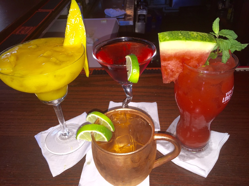While you're at the bar, why not try some of our new drink specials? Clockwise from the left: Mango Margarita, Triple Berry Martini (made with fresh organic berries), Watermelon Mojito, and in the mug is our Moscow Mule.
