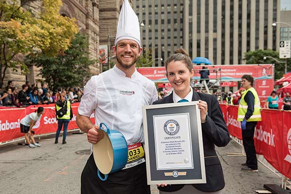 Daniel Janetos after the 2016 Scotiabank Toronto Waterfront Marathon, after achieving the Guinness World Record for fastest marathon dressed as a chef, carrying a three kilogram pot.
