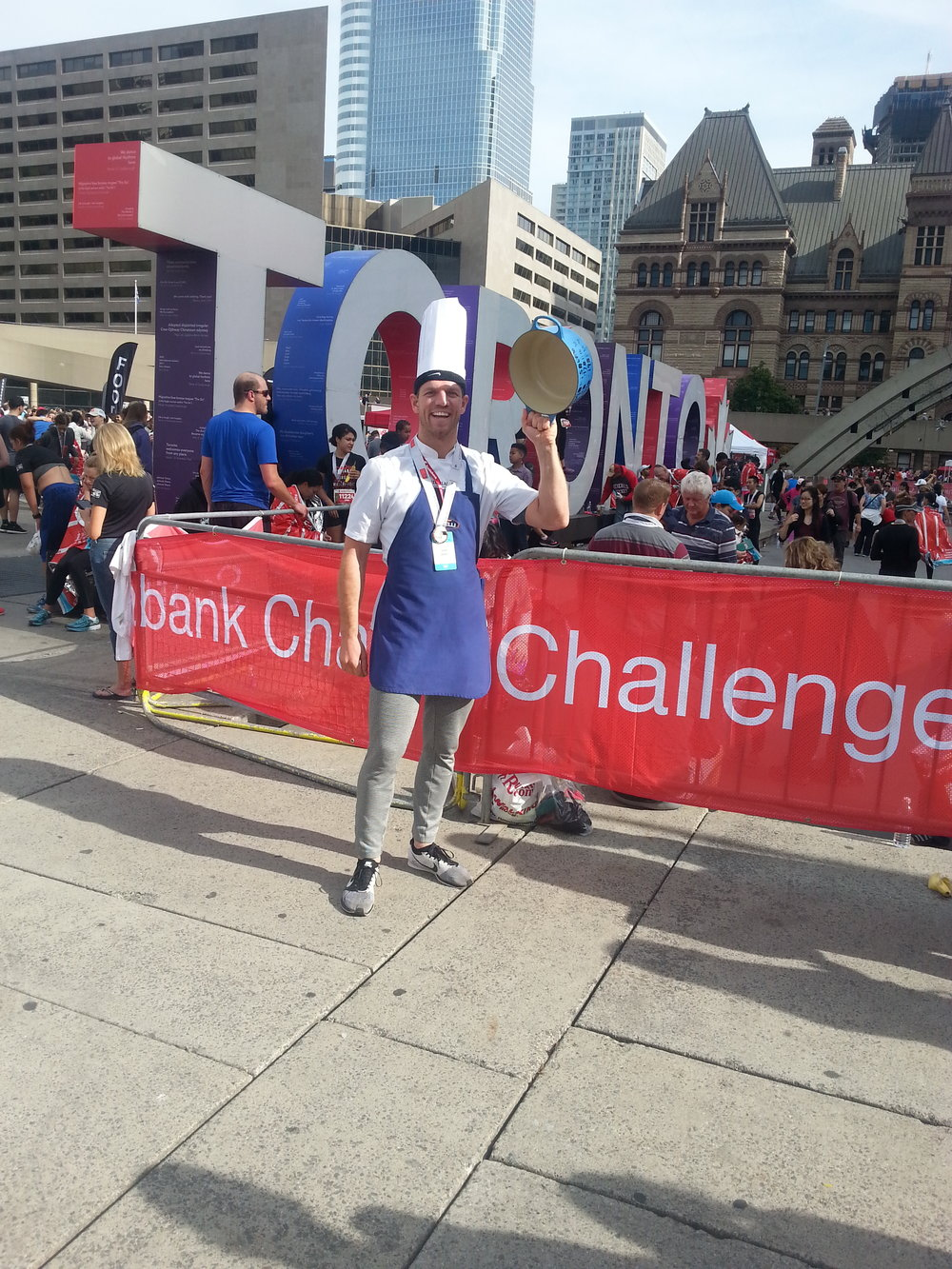 Daniel Janetos at the 2017 Scotiabank Toronto Waterfront Marathon, where he beat the Guinness World Record for fastest half-marathon dressed as a chef carrying a 3 kg pot!