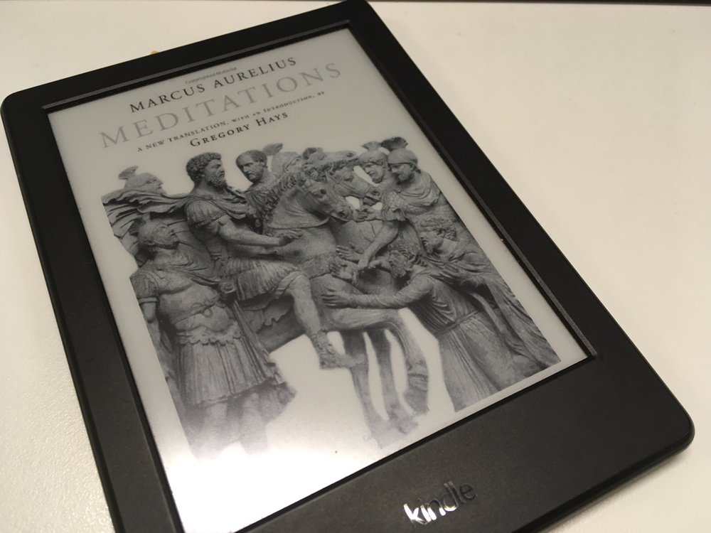 In real life, this book would probably weigh quite a bit. I'm glad it's in this little Kindle instead.