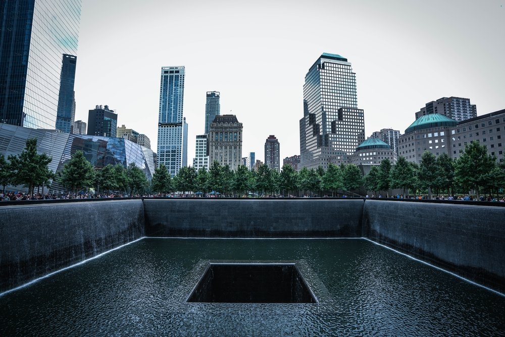The memorial at the site of the former World Trade Center, present day. By  Axel Houmadi .