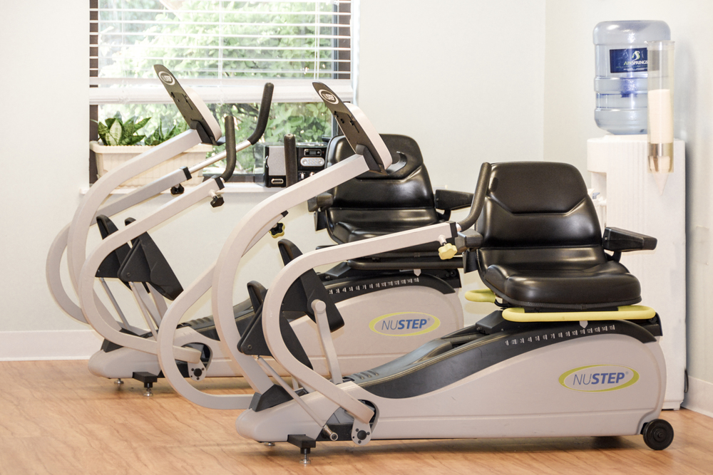 This picture shows two machines in our rehab gym.  One of our therapists may recommend using these machines for low-impact rehabilitation.  These machines have wheelchair access and they help our residents with many of their Assisted Daily Living activities such as walking up stairs.