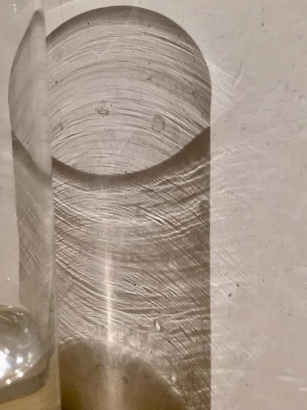 I wake to find that the light has transformed the glass of water on my bedside table.