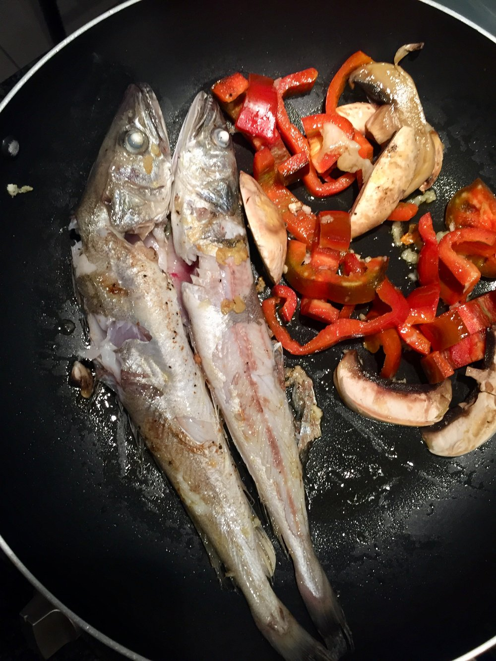 Pan fried hake with homegrown peppers.