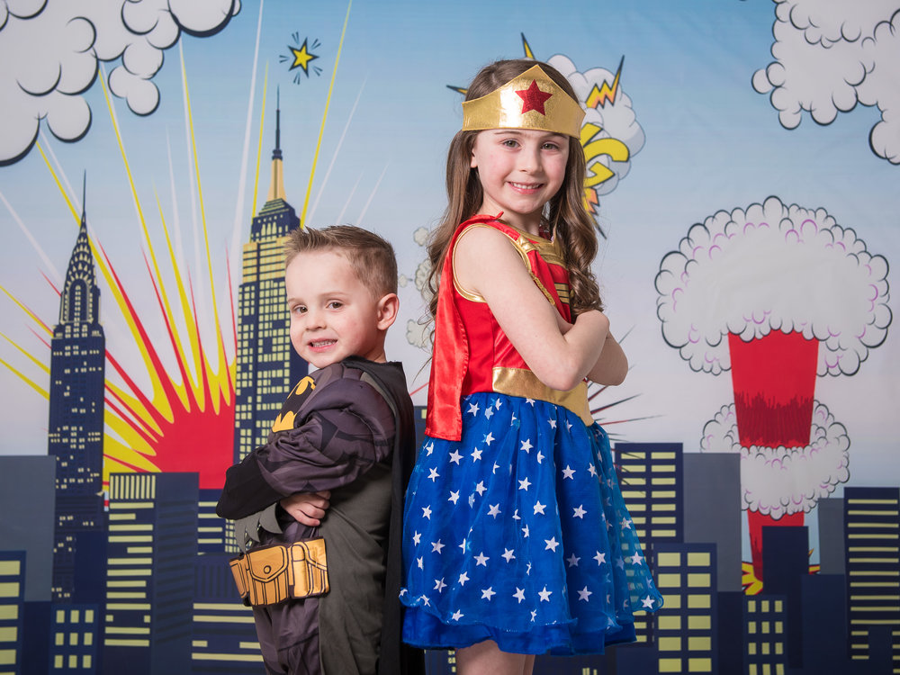Brother & sister dressed up as superheroes Batman & wonder woman