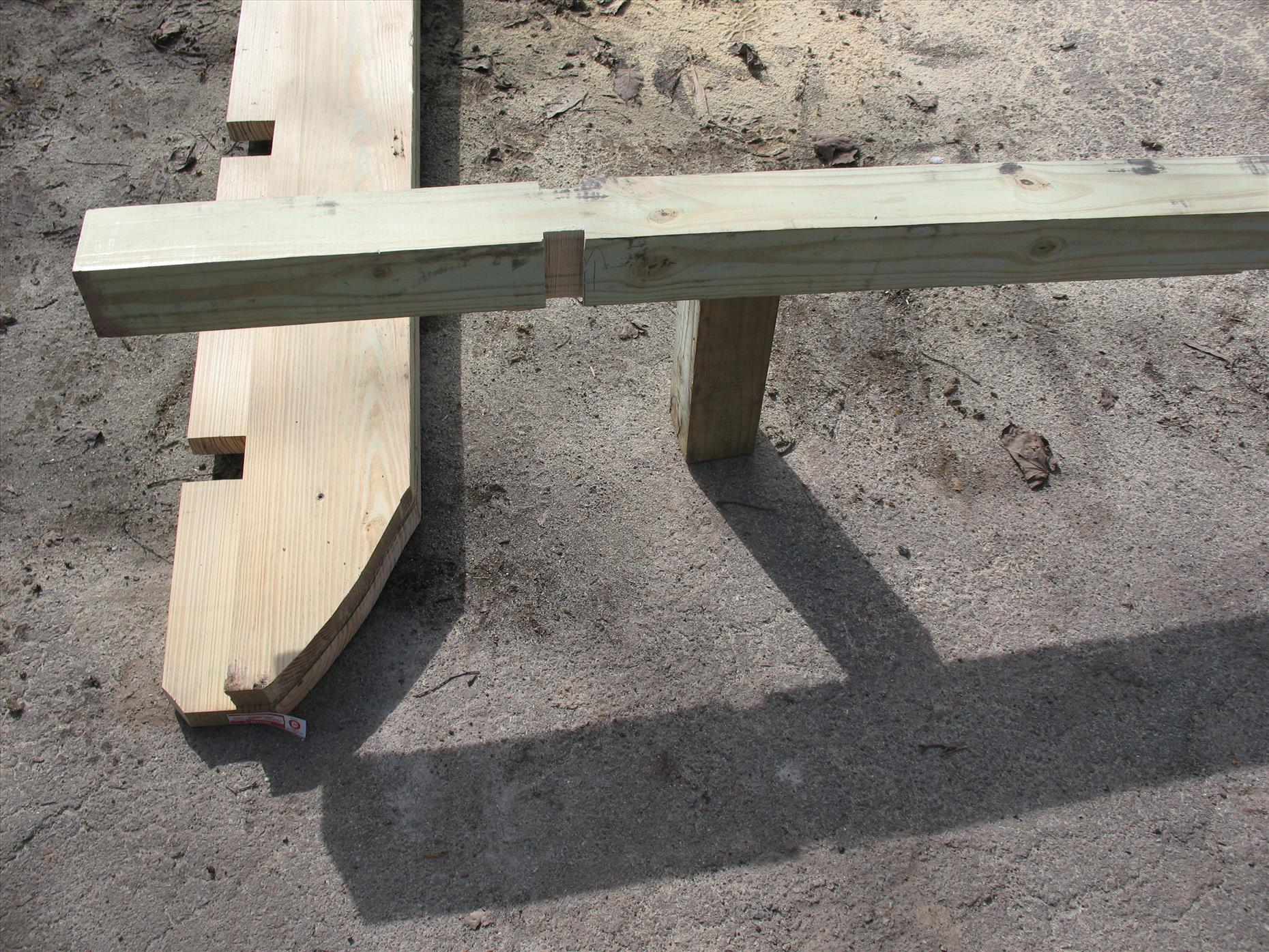 Here's a close up of one of the skids (a bolted together 2x12 and 2x8) and the notched 4x4 floor joist.