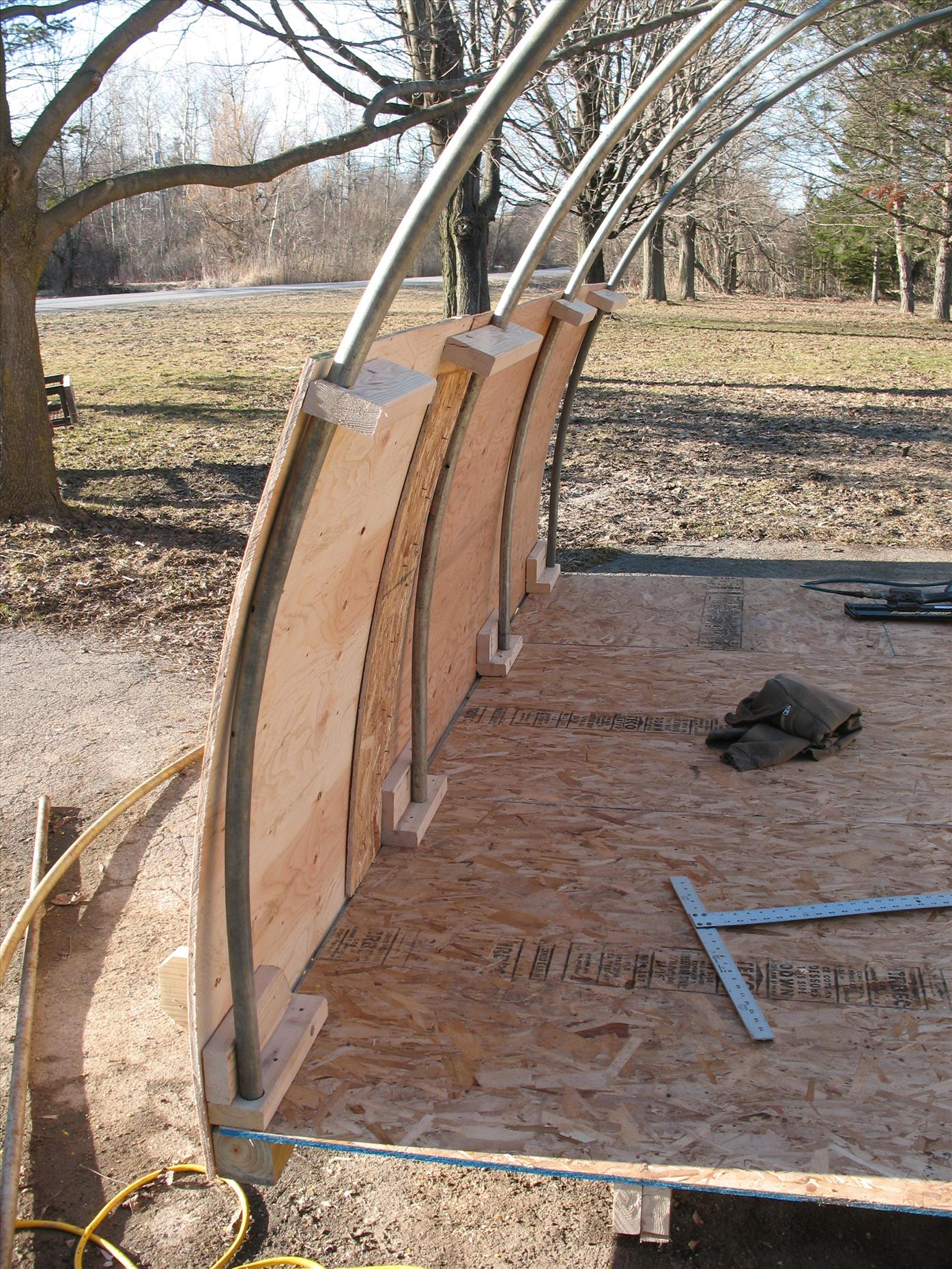 Attaching the frame bents and exterior plywood sheathing (to deter larger predators).