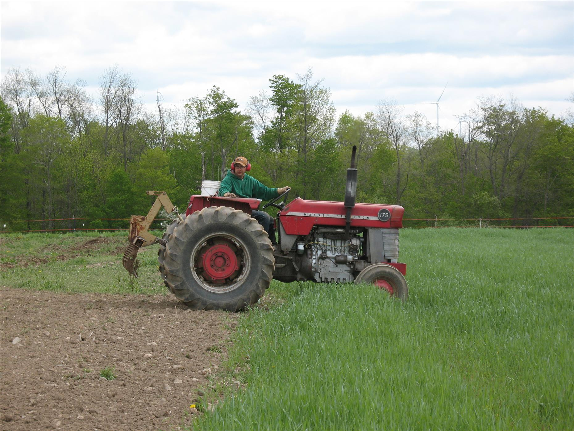 Matt working up the potato field with the scarifier.