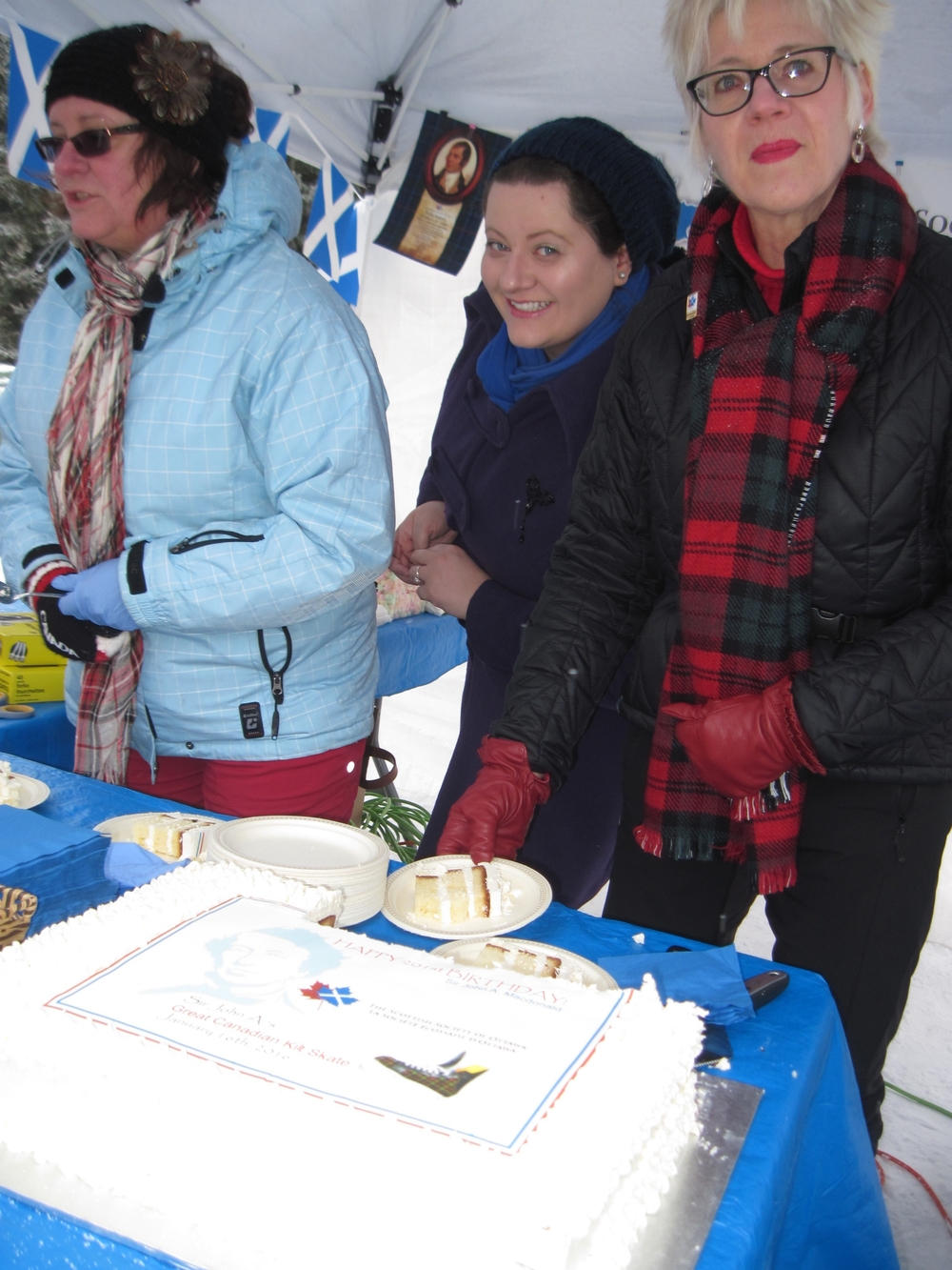 Meanwhile, with Sue MacGregor, Sabrina Sotiriu, and Janet Detillieux, there's a big demand for hot chocolate and a piece of Sir John A's birthday cake...