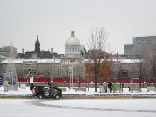 The Zamboni grooms the ice, with the bonsesours market in the background.