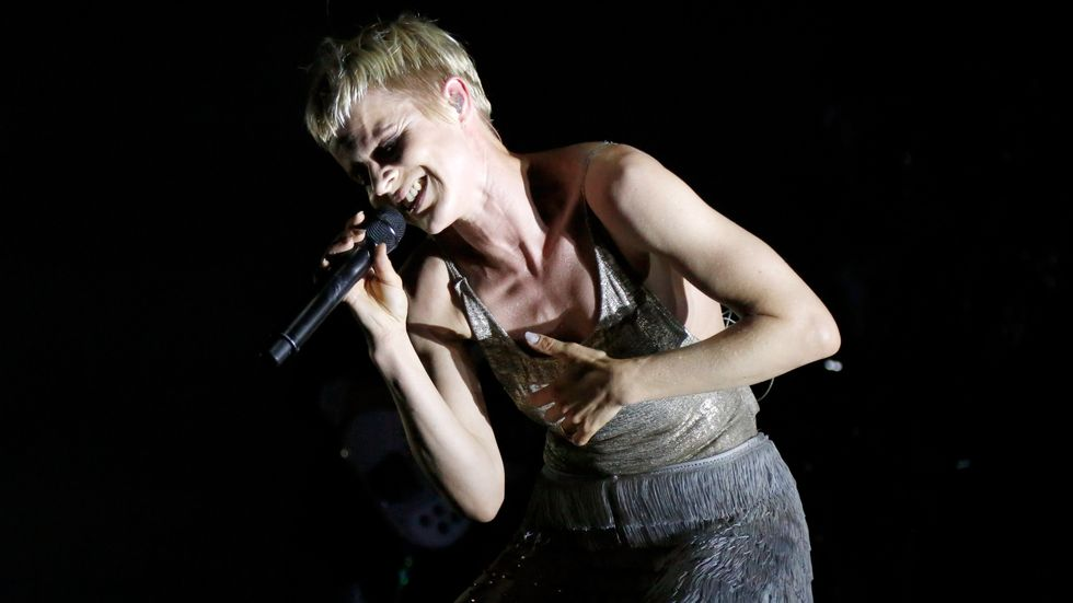 Robyn performs opposite The Strokes to close out the festival's opening night.