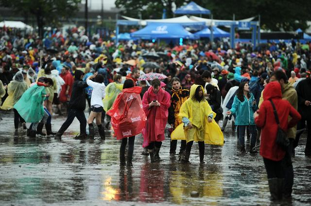 Fans navigate a sea of mud at Governors Ball 2013.