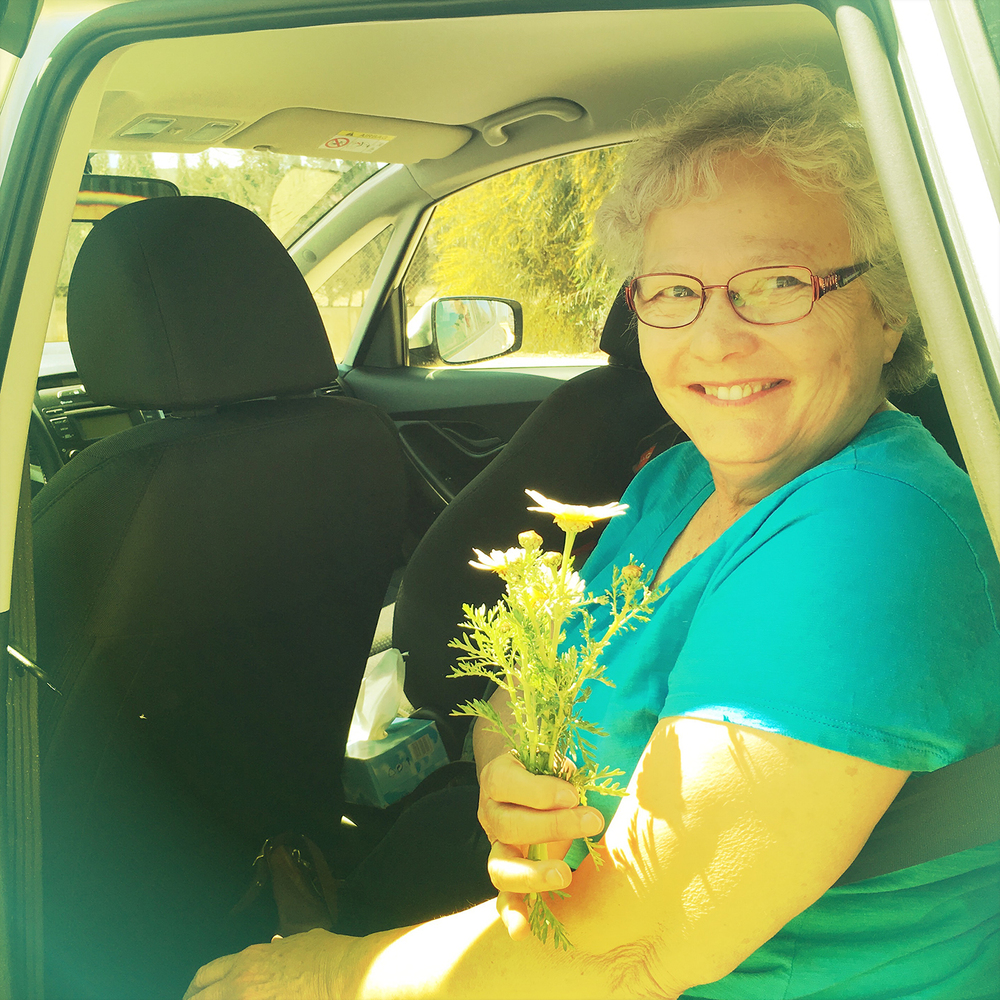 Mom with flowers-Herrera.jpg