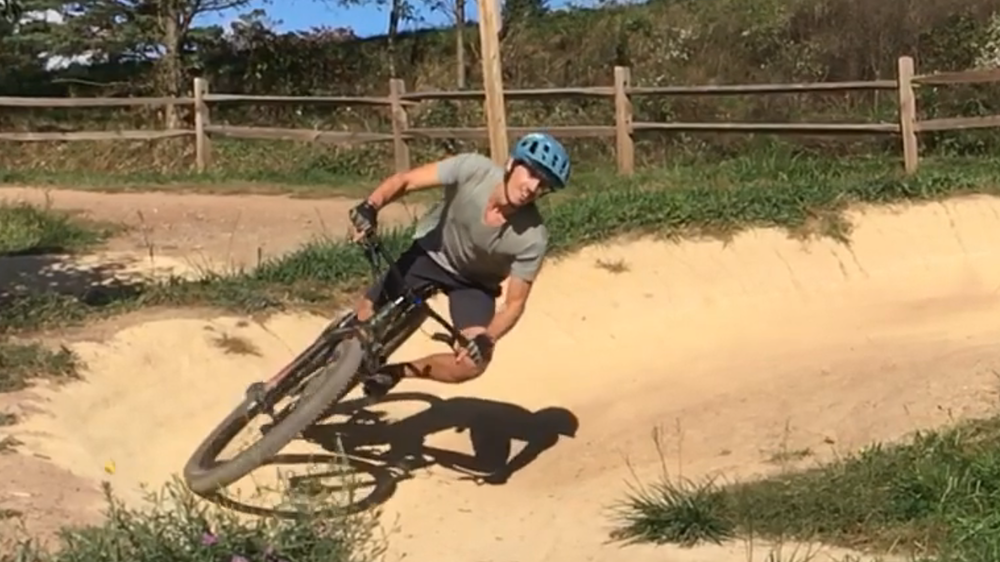 Matt practices cornering on the berms
