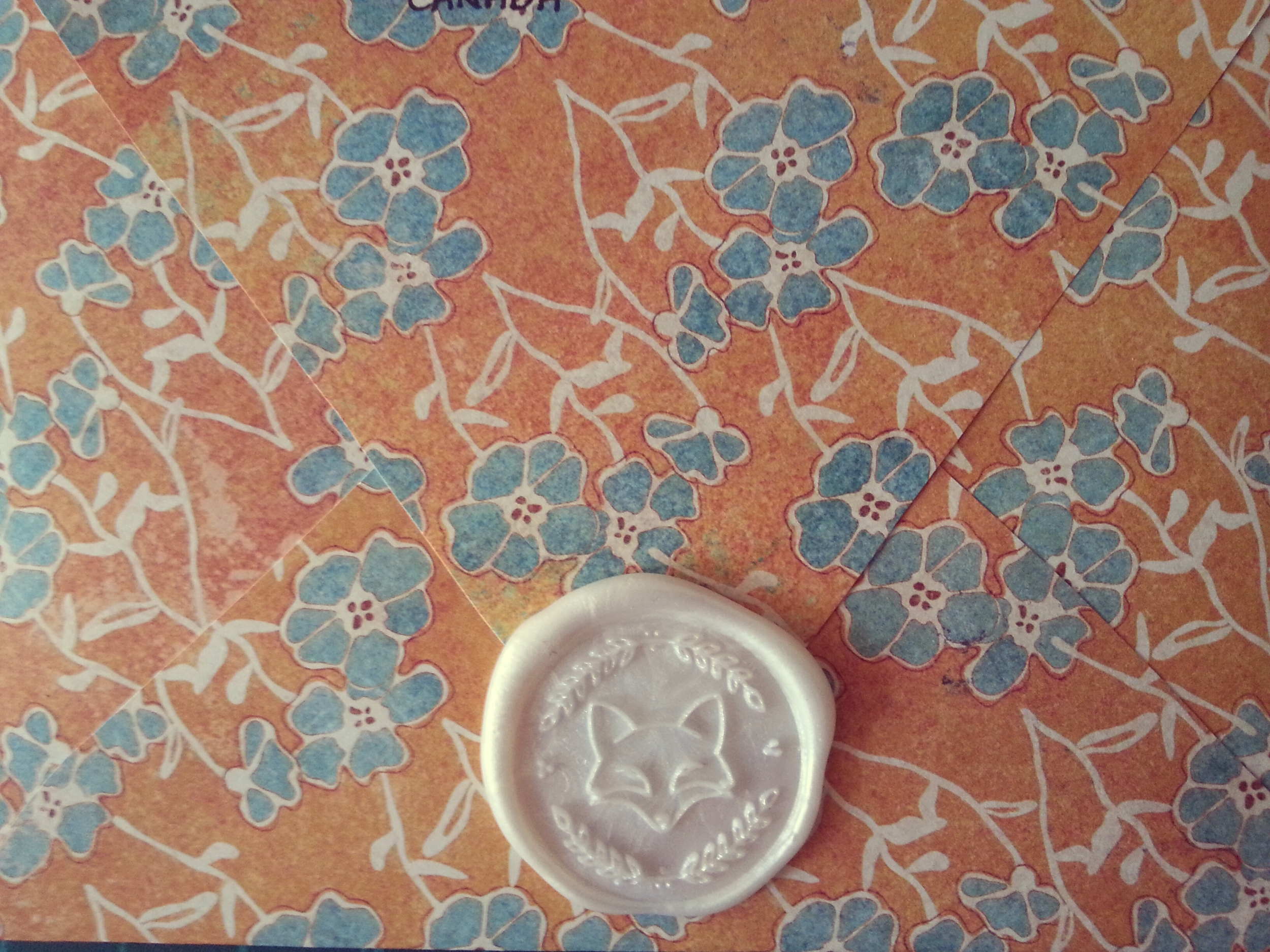 Handmade envelopes from patterned scrapbook paper sealed with a pretty wax sticker from fox and quills