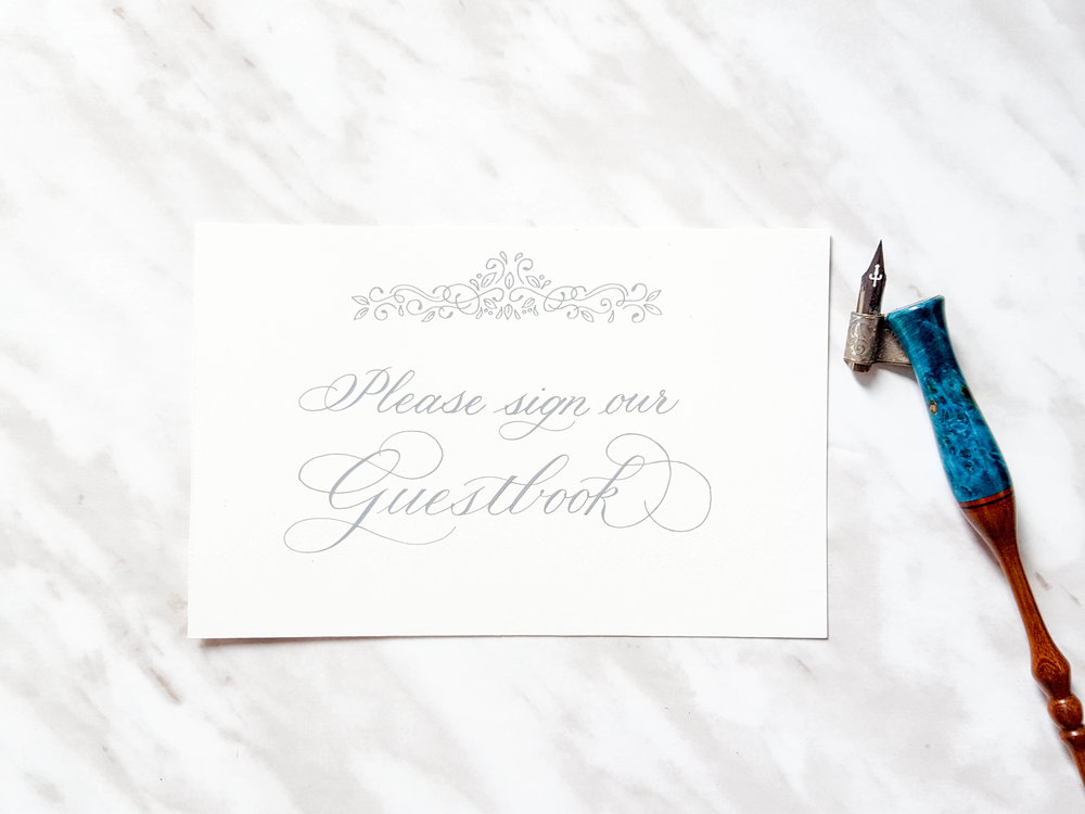 Hand written guestbook sign in grey gouache