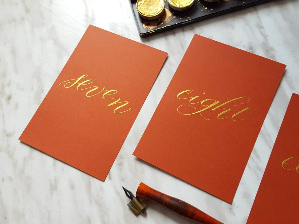 Gold on red table numbers