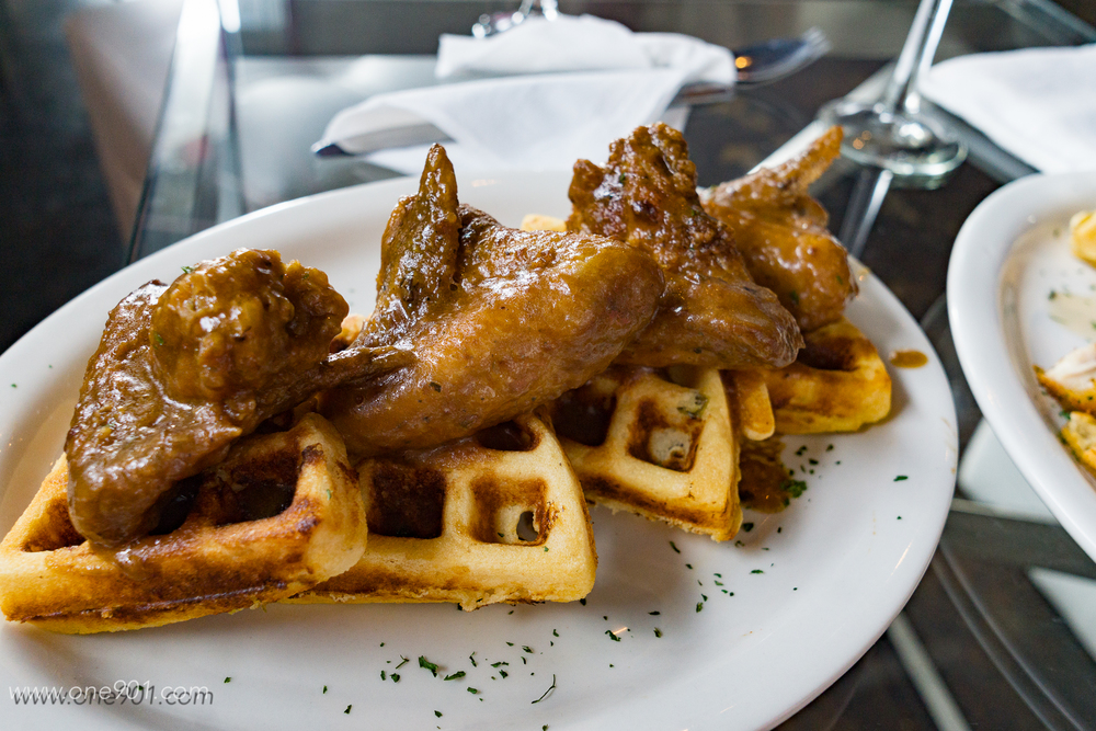 Smothered chicken with cornbread waffle
