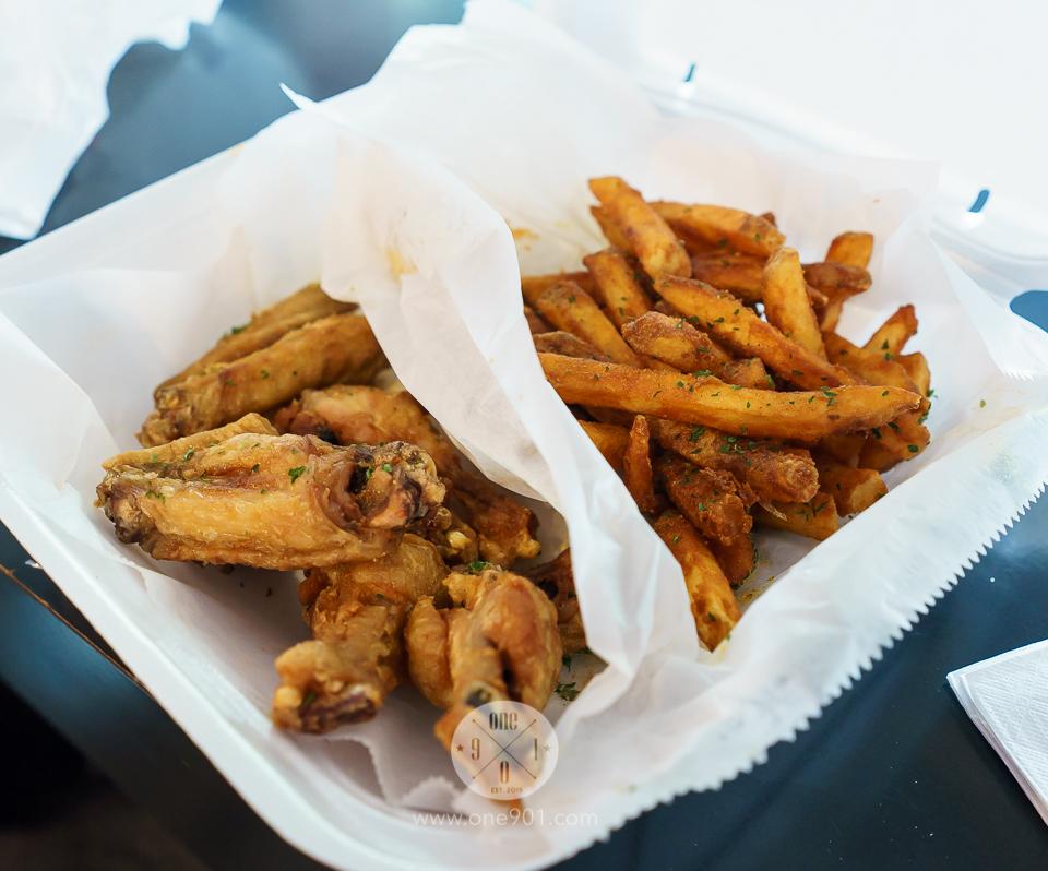 Seasoned wings with seasoned fries