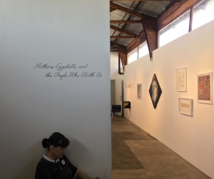 Kim Abeles at the entrance of the exhibition.