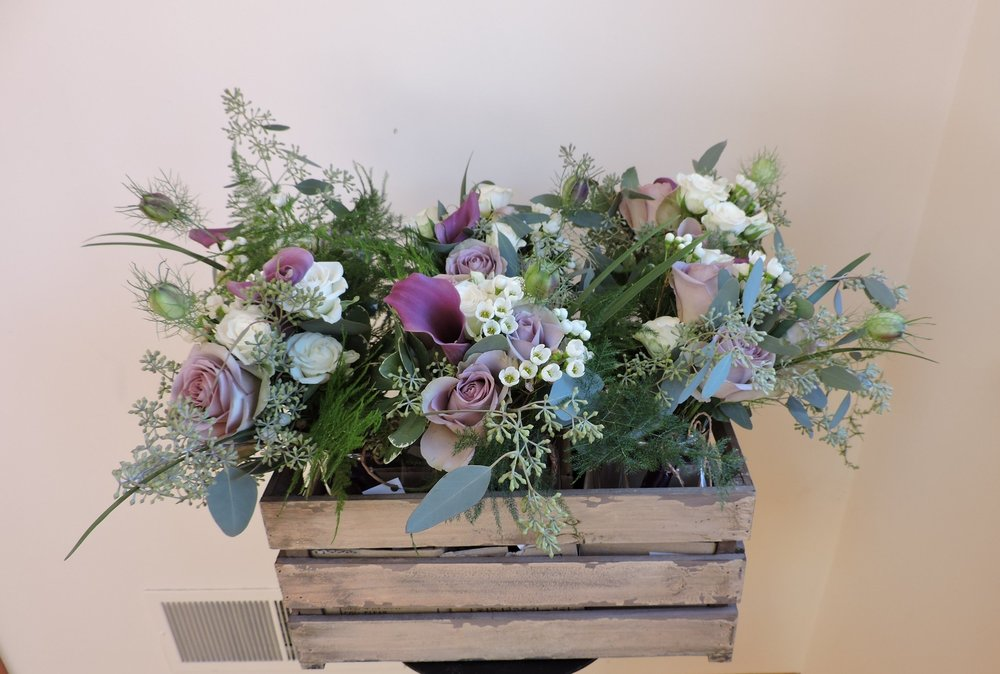 Bridesmaids' bouquets delivered in crate suitable for display at the reception