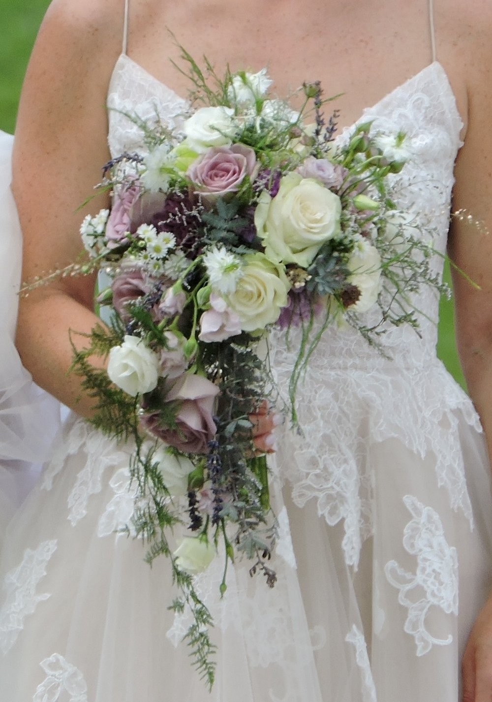 Romantic, cascade bouquet with fine textures evoking feelings of lace