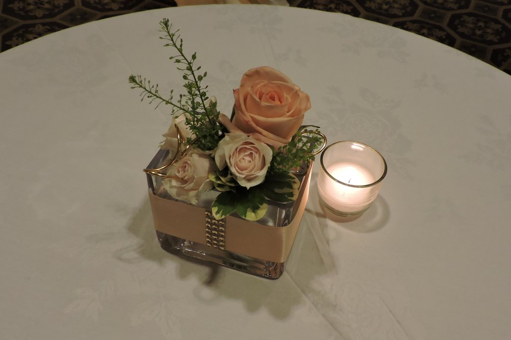 Petite clutch of flowers in embellished glass adorns cocktail table at the Omni Parker House.