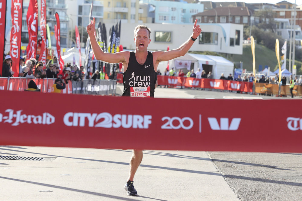 Images: Ben St Lawrence winning 2018 City2Surf.