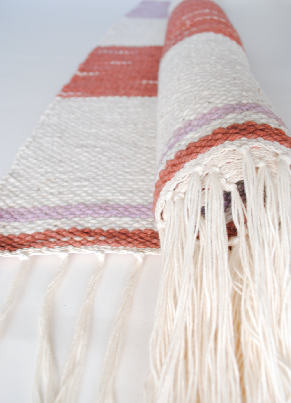 WEGATHER_Handwoven_UnionRug_Russet_Dusk_Cream_Roll.JPG